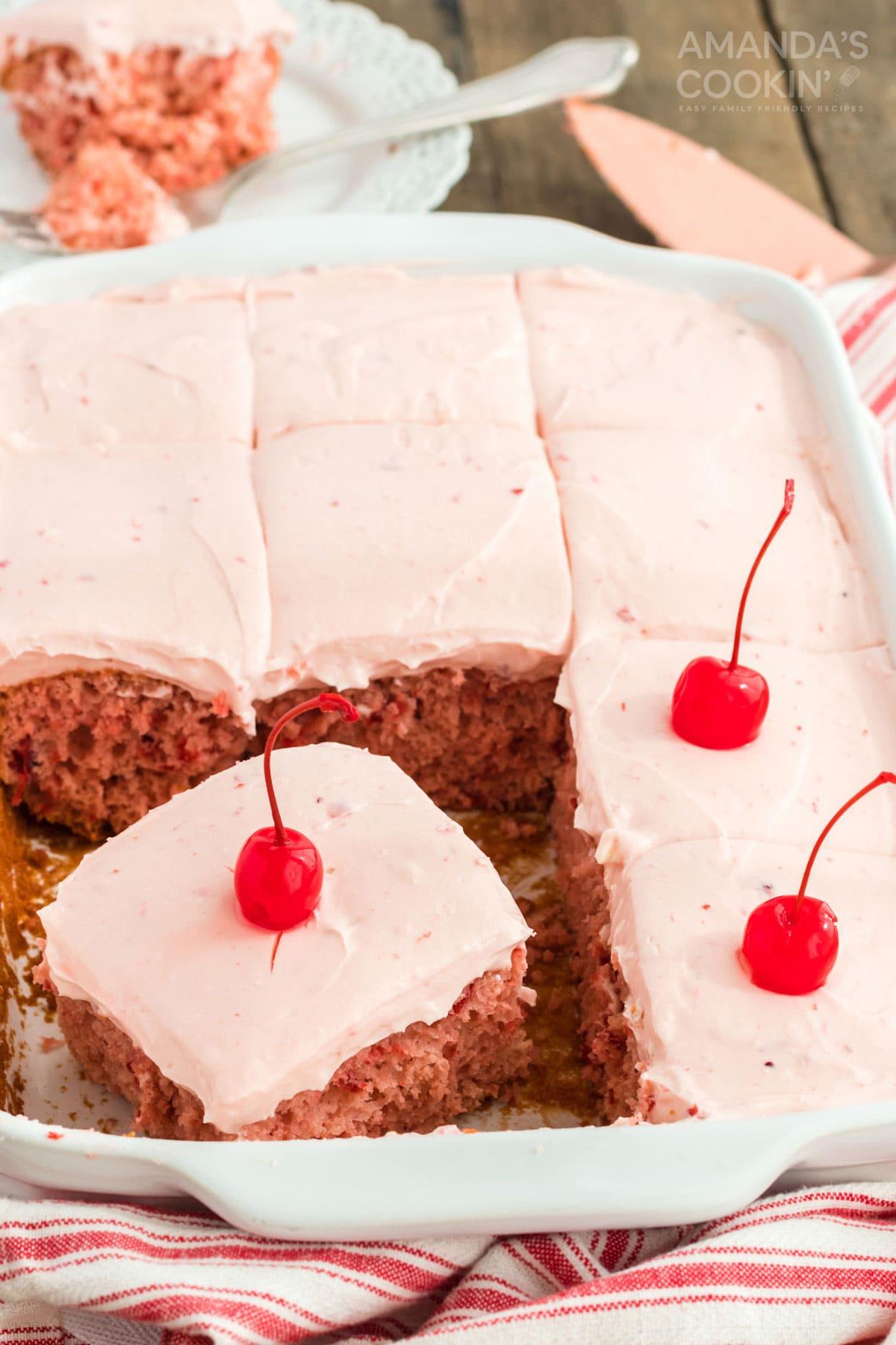 pan of cherry cake topped with maraschino cherries