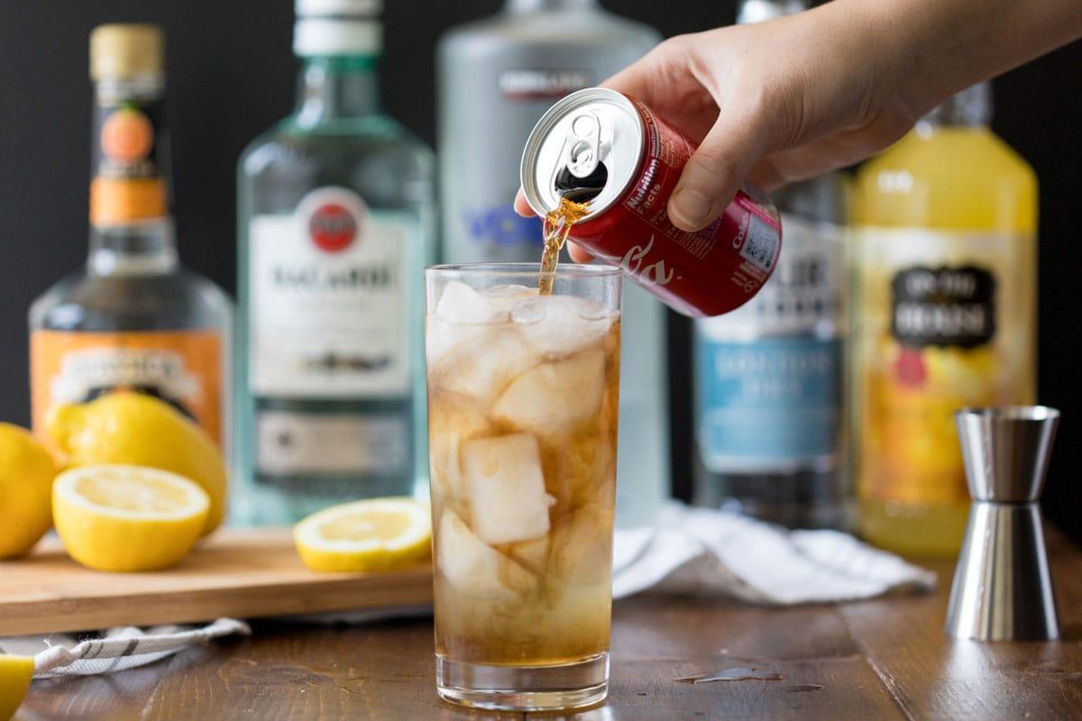 adding cola to a long island iced tea