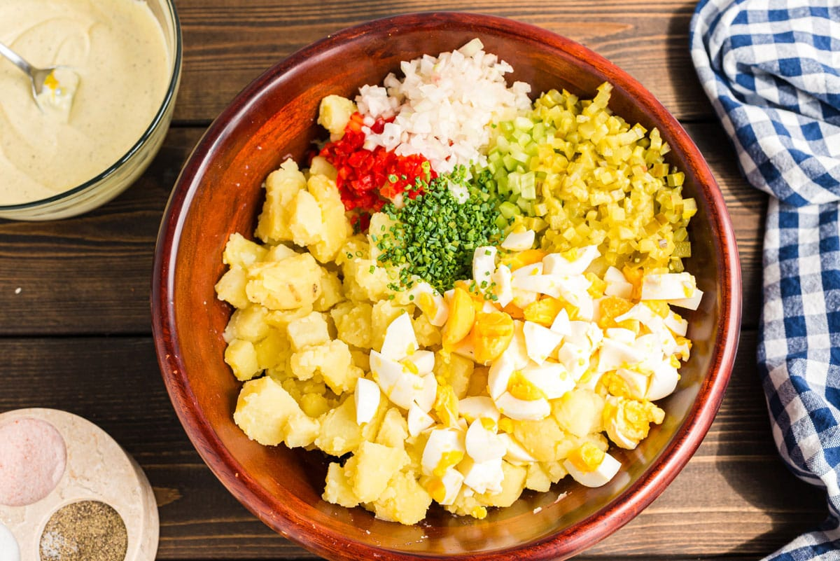 all potato salad ingredients in a bowl