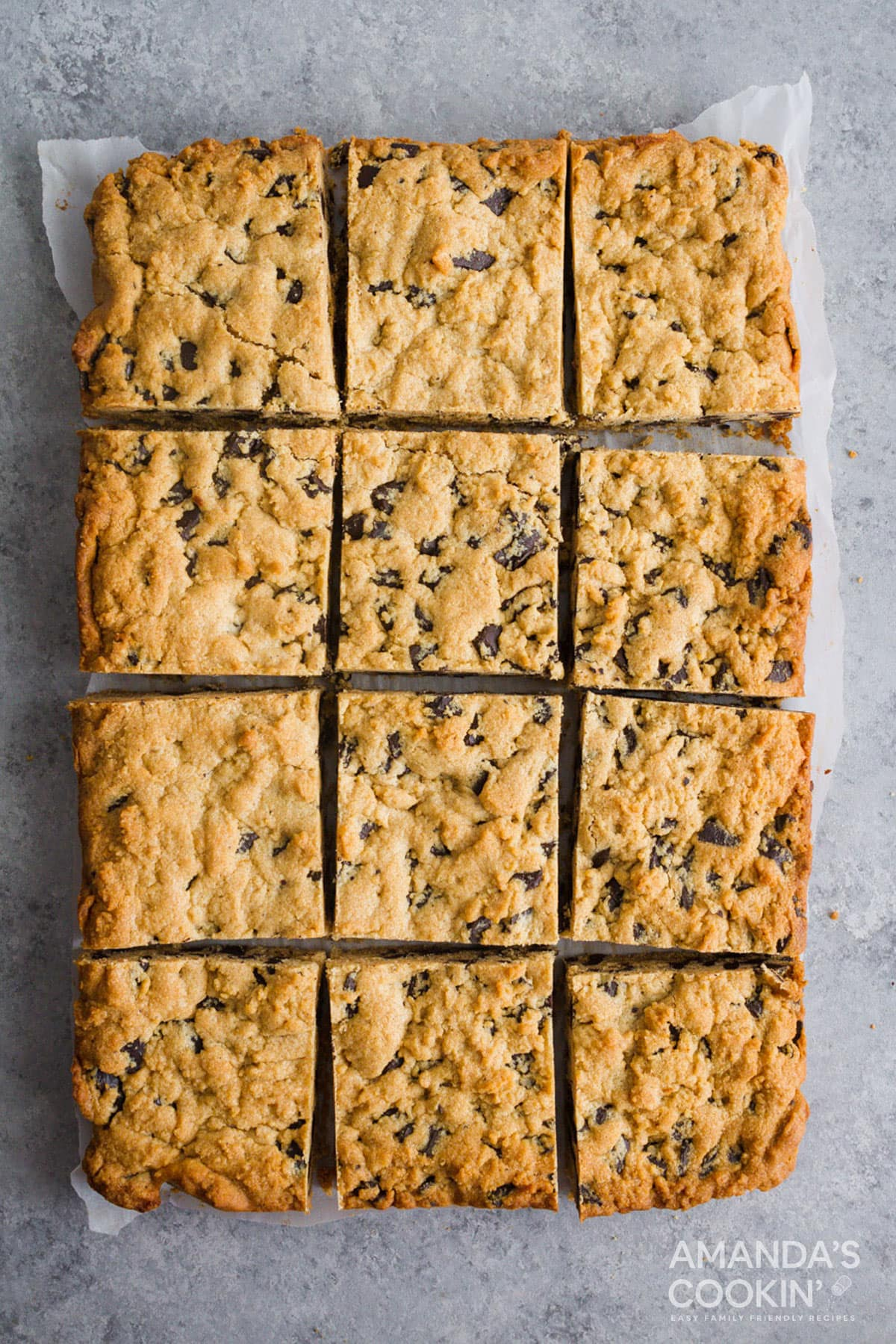 overhead view of peanut butter chocolate chunk bars on parchment paper