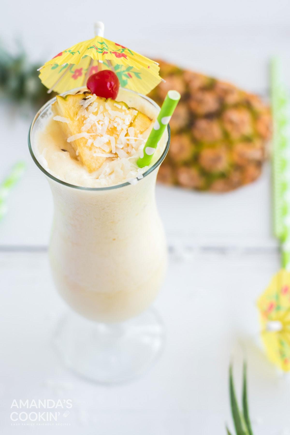 white pina colada with cherry and pineapple garnish