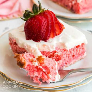 slice of strawberry cake with a fork