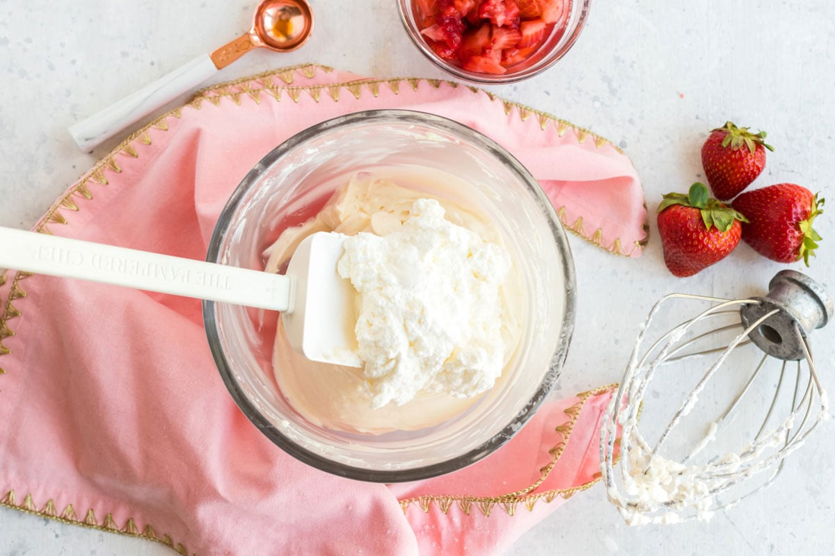 folding whipped cream into cream cheese mixture