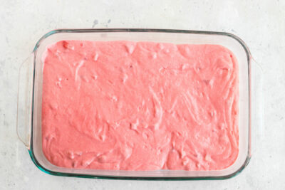 pink cake batter in a 13x9 pan