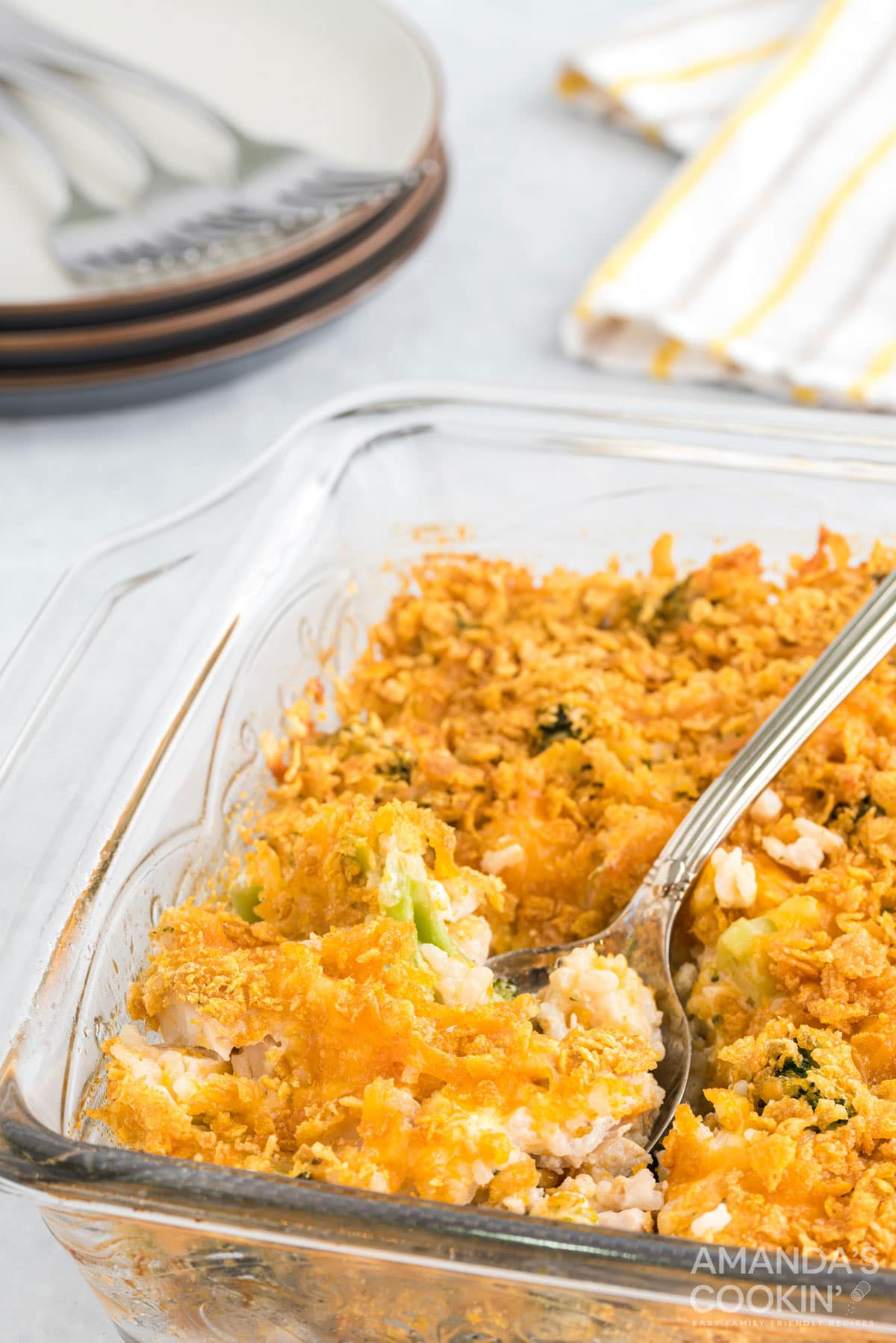 glass dish of Make Chicken Broccoli Rice Casserole with a spoon