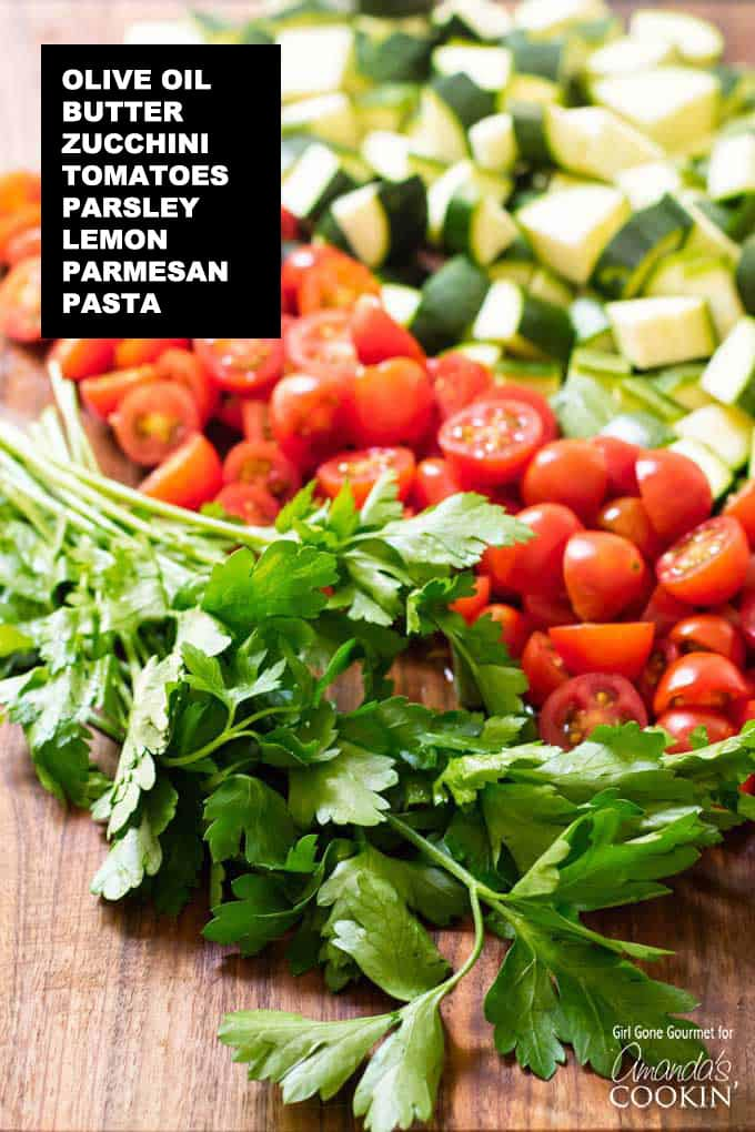 parsley, tomatoes, zucchini on a cutting board