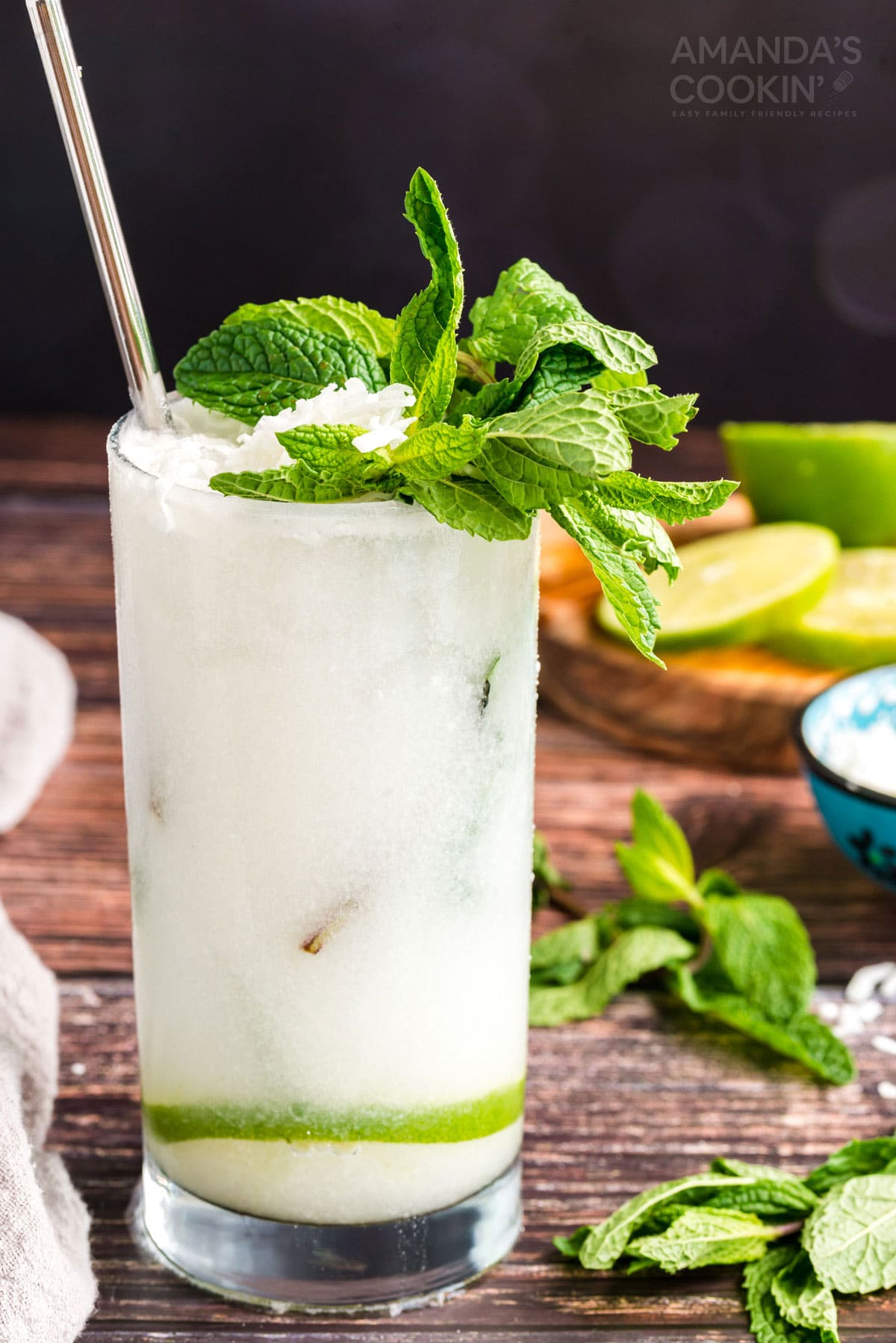 glass of coconut mojito garnished with mint