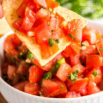 tortilla chip topped with salsa fresca