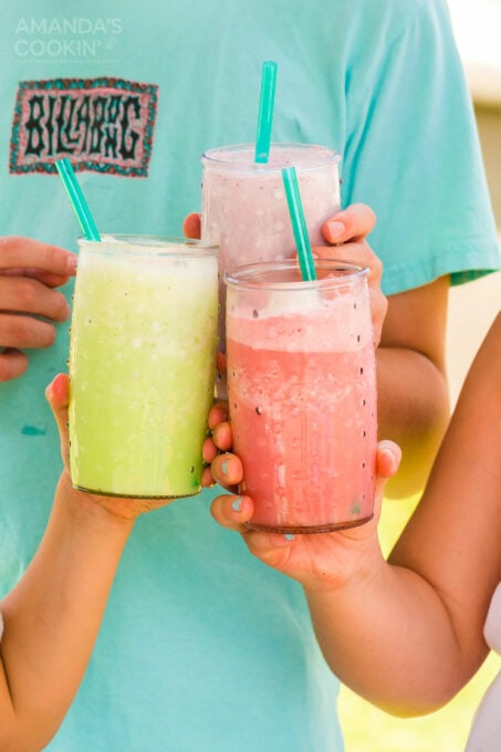 kids holding slushies