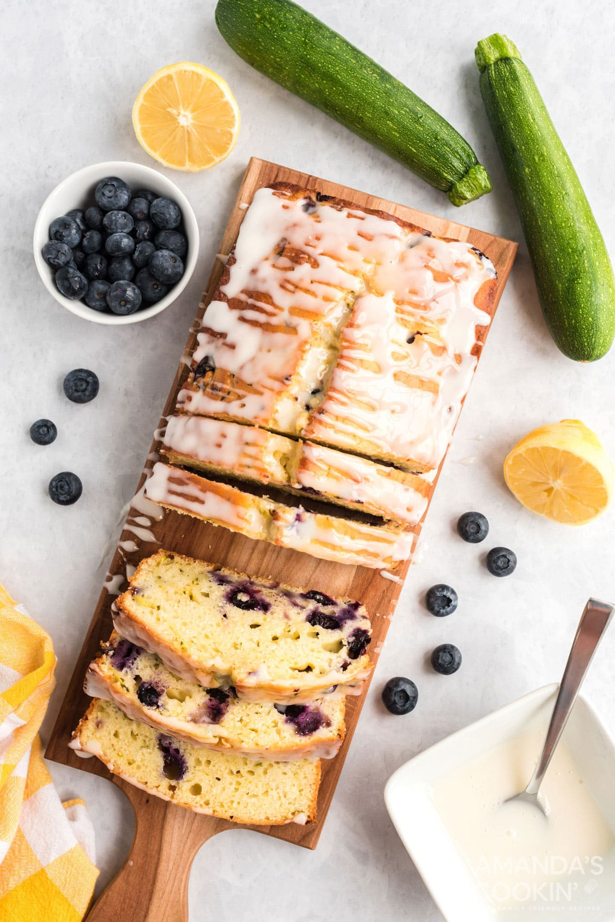 overhead photo of sliced lemon blueberry zucchini bread on a cutting board