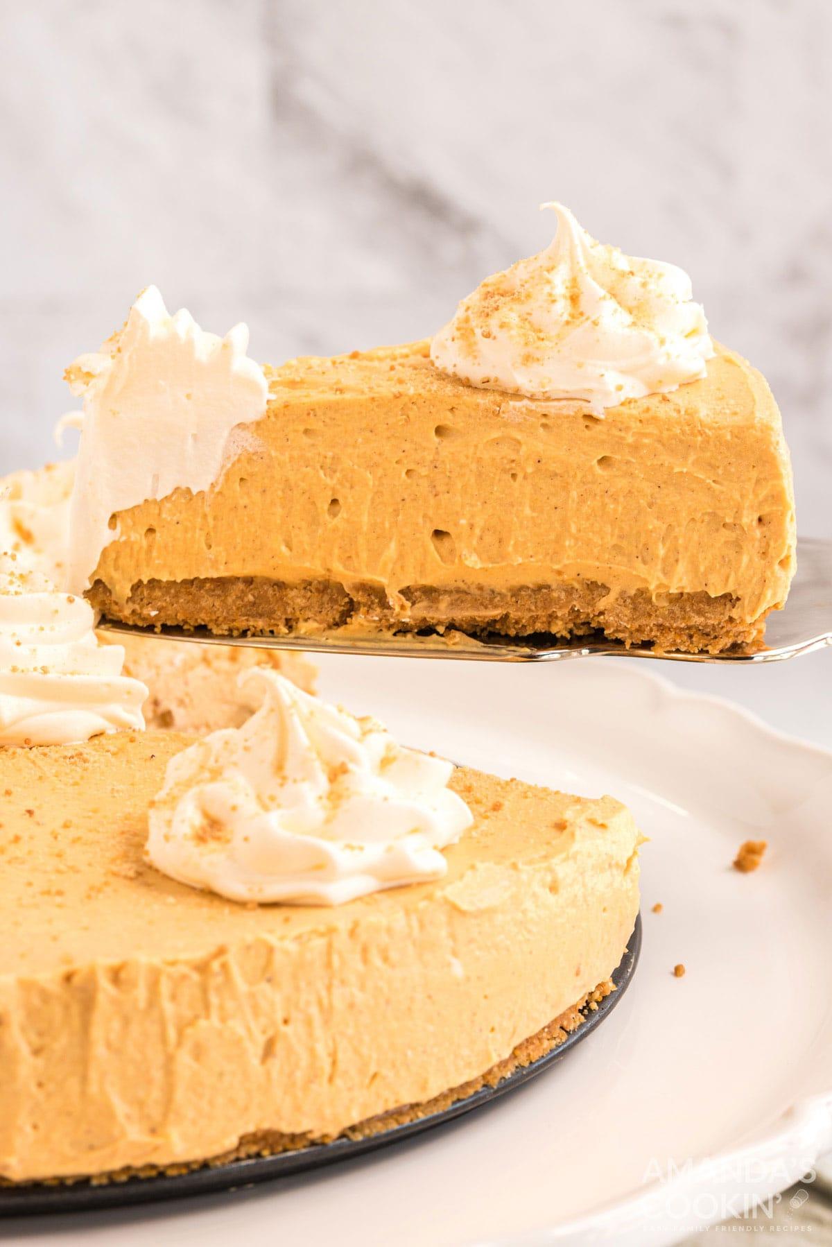removing a slice of no bake pumpkin cheesecake