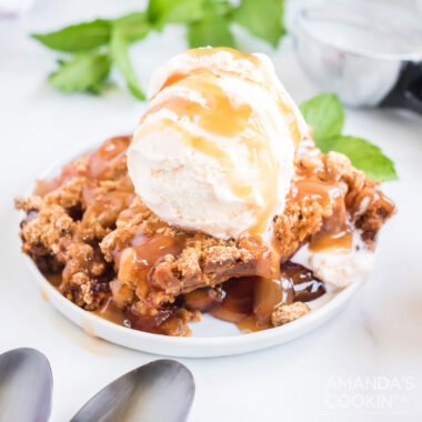 dish of crockpot apple cobbler with vanilla ice cream