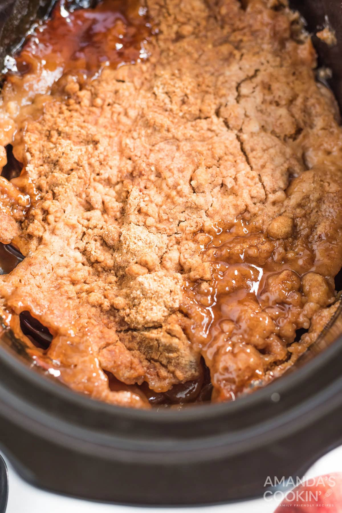 apple dump cake that has been cooked in a crockpot
