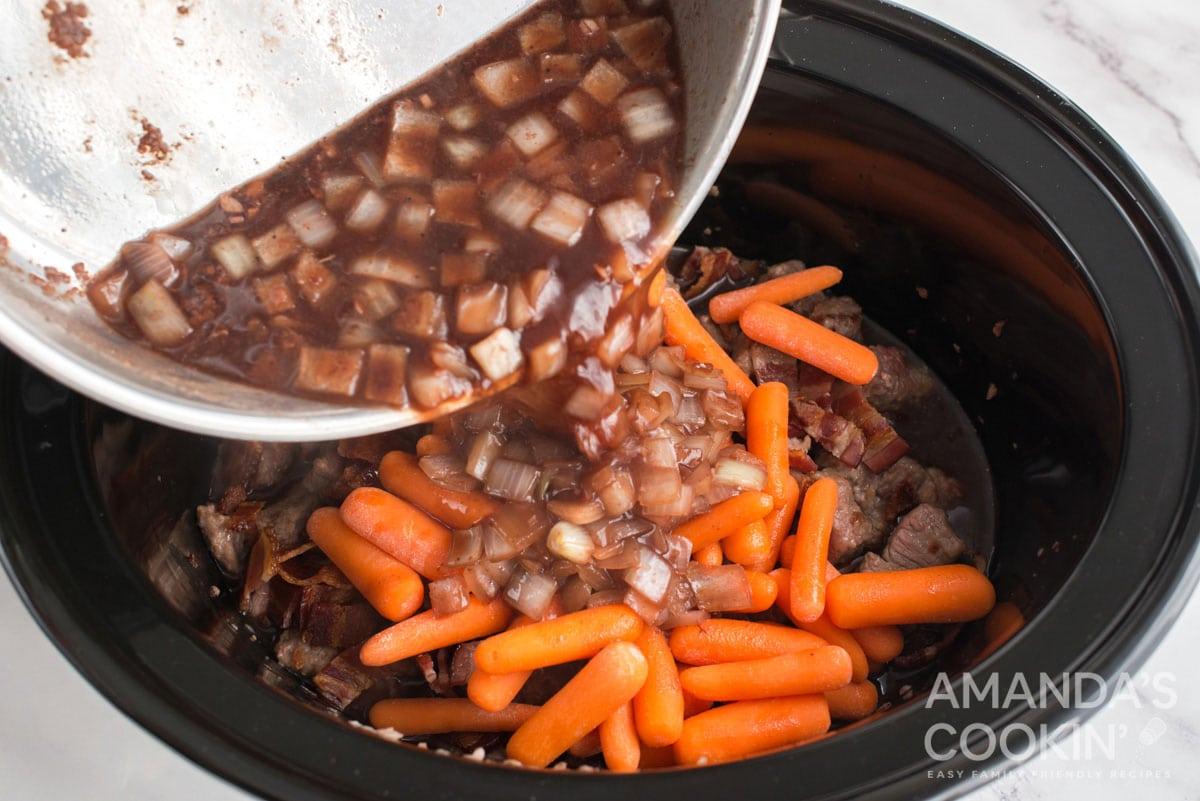 adding wine mixture to crockpot