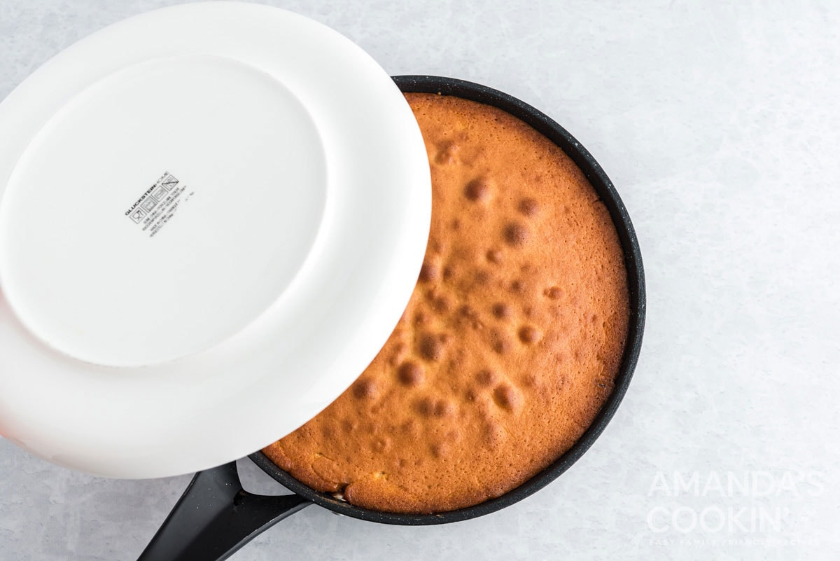 placing plate over the top of cake pan