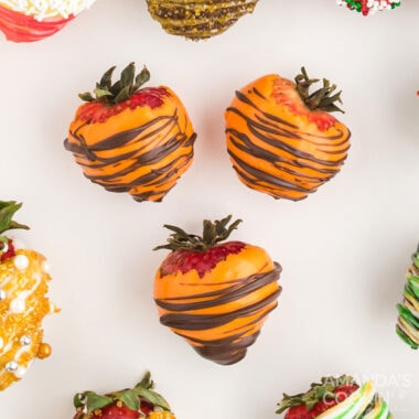 3 orange and brown chocolate covered strawberries