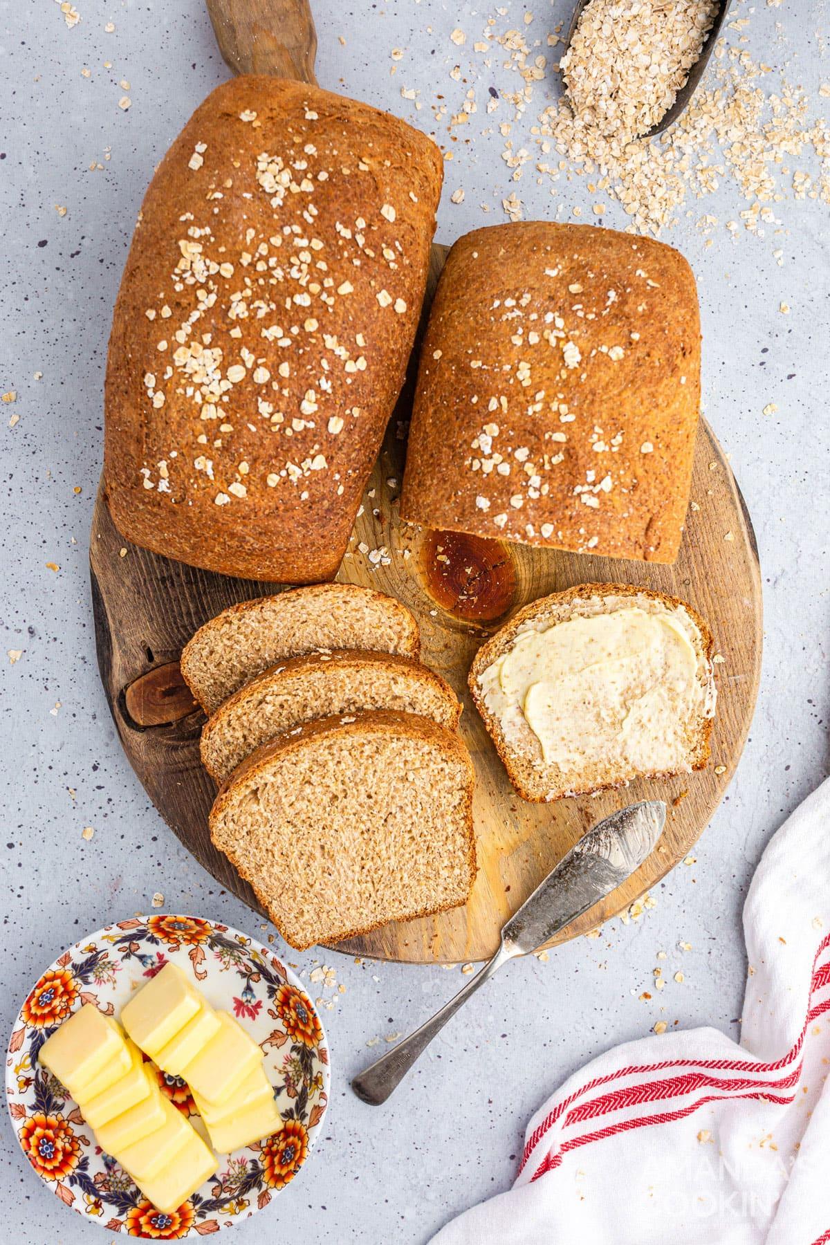2 loaves of multigrain bread on a wooden board