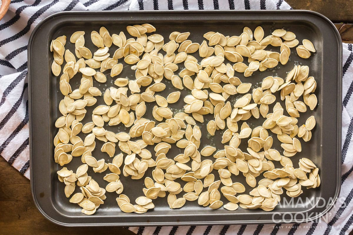 pumpkin seeds on pan ready for oven