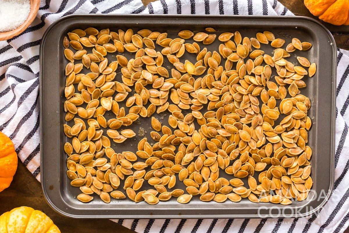 pan full of roasted pumpkin seeds