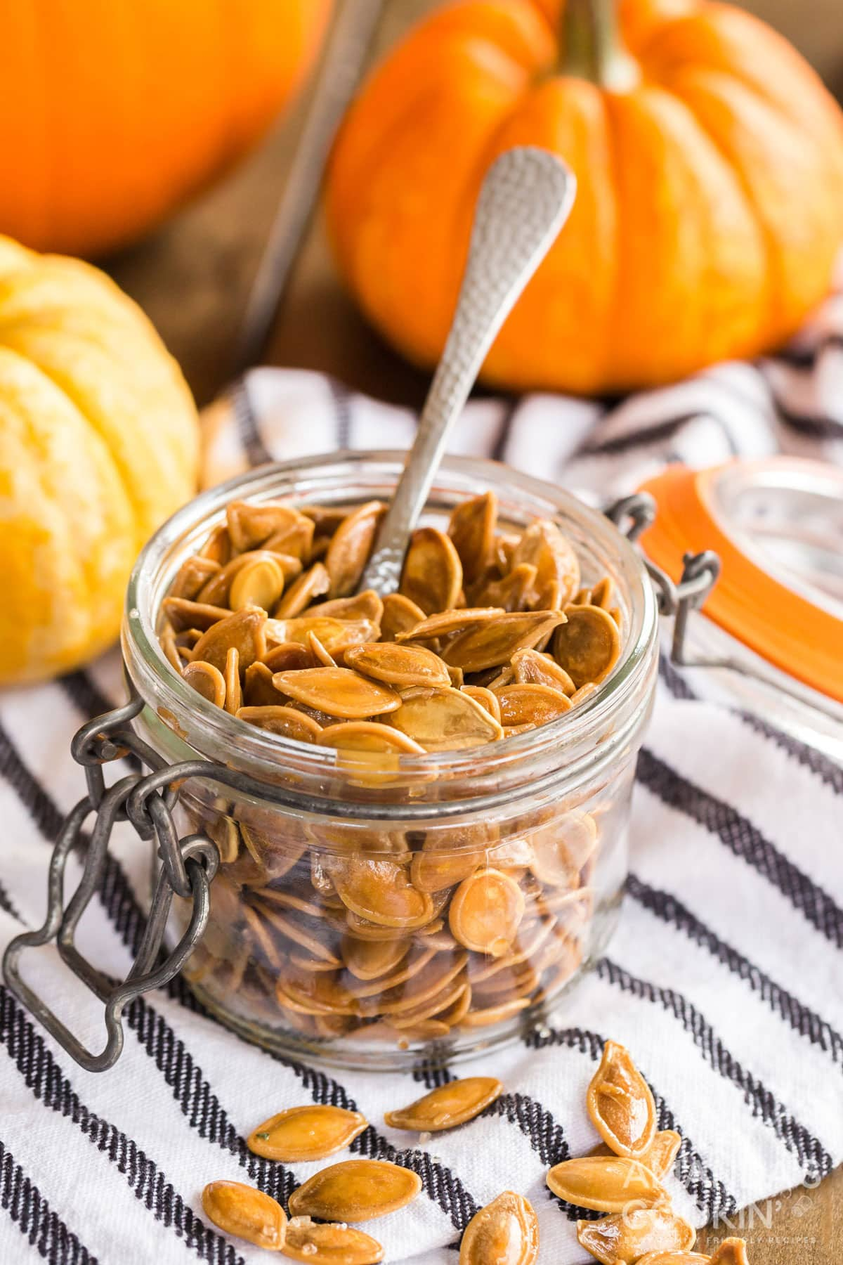 small jar of pumpkin seeds with a spoon