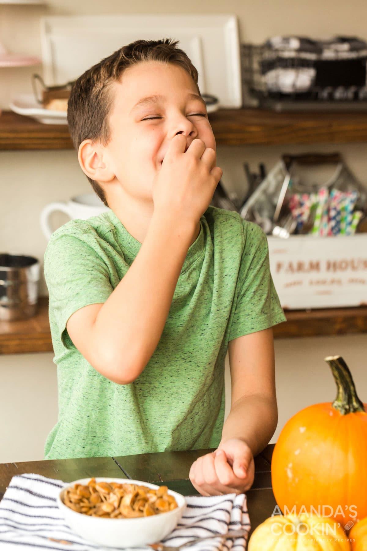 child eating roasted pumpkin seeds