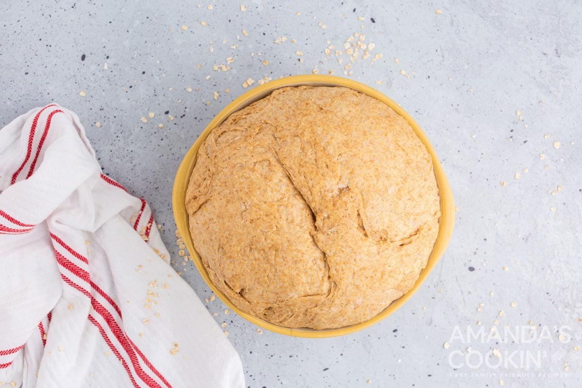 full bowl of bread dough that has risen