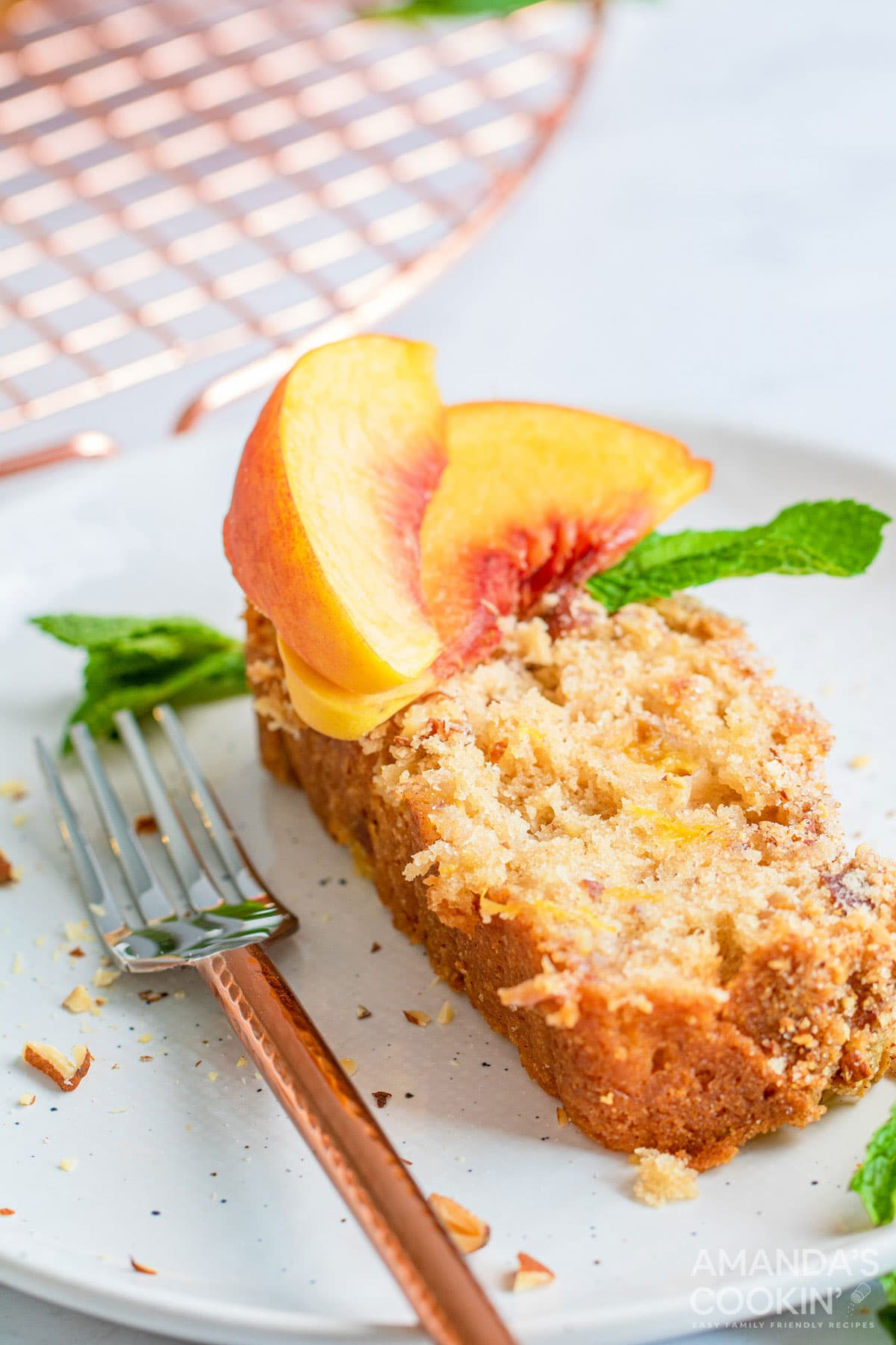 slice of peach bread on a plate with a fork