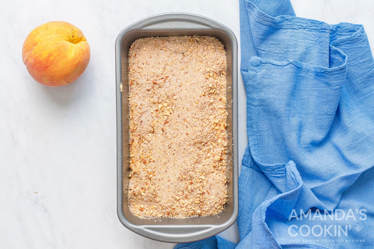 peach bread batter with topping in pan