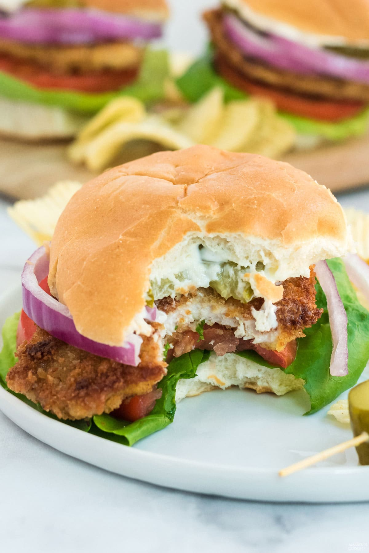 pork tenderloin sandwich with bite out of it