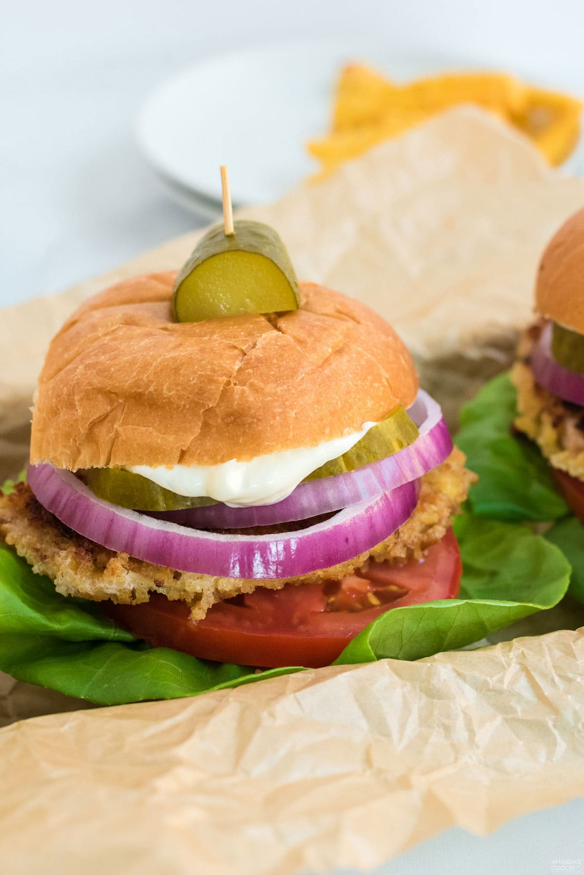 pork tenderloin sandwich with a pickle garnish