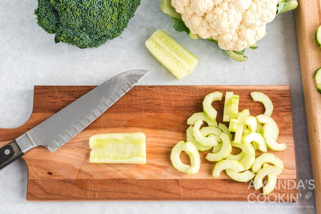 cored cucumber on a cutting board