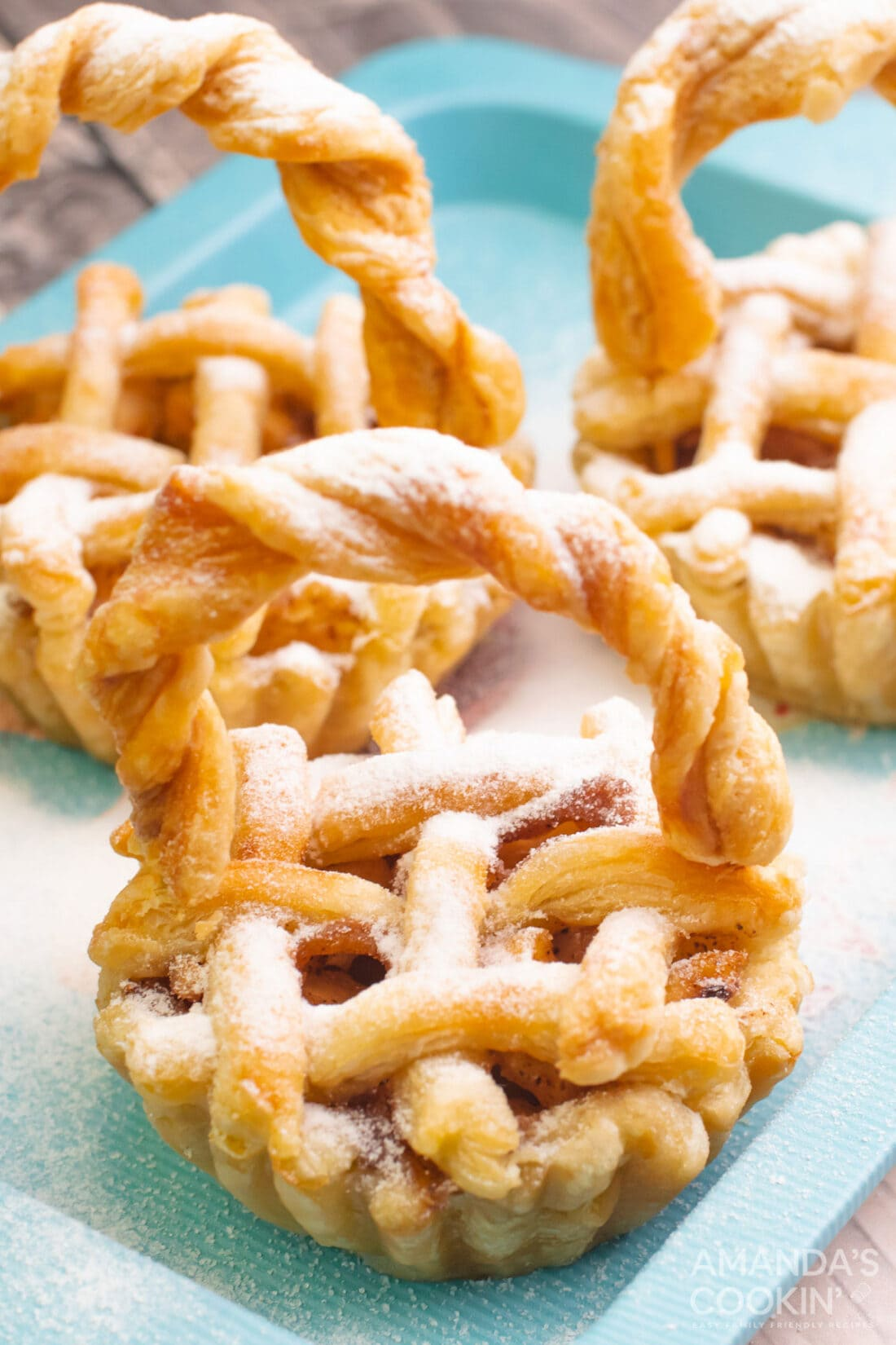 mini apple pies dusted with powdered sugar