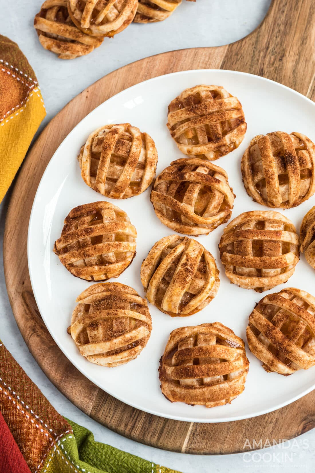 apple pie cookies on a round cutter board