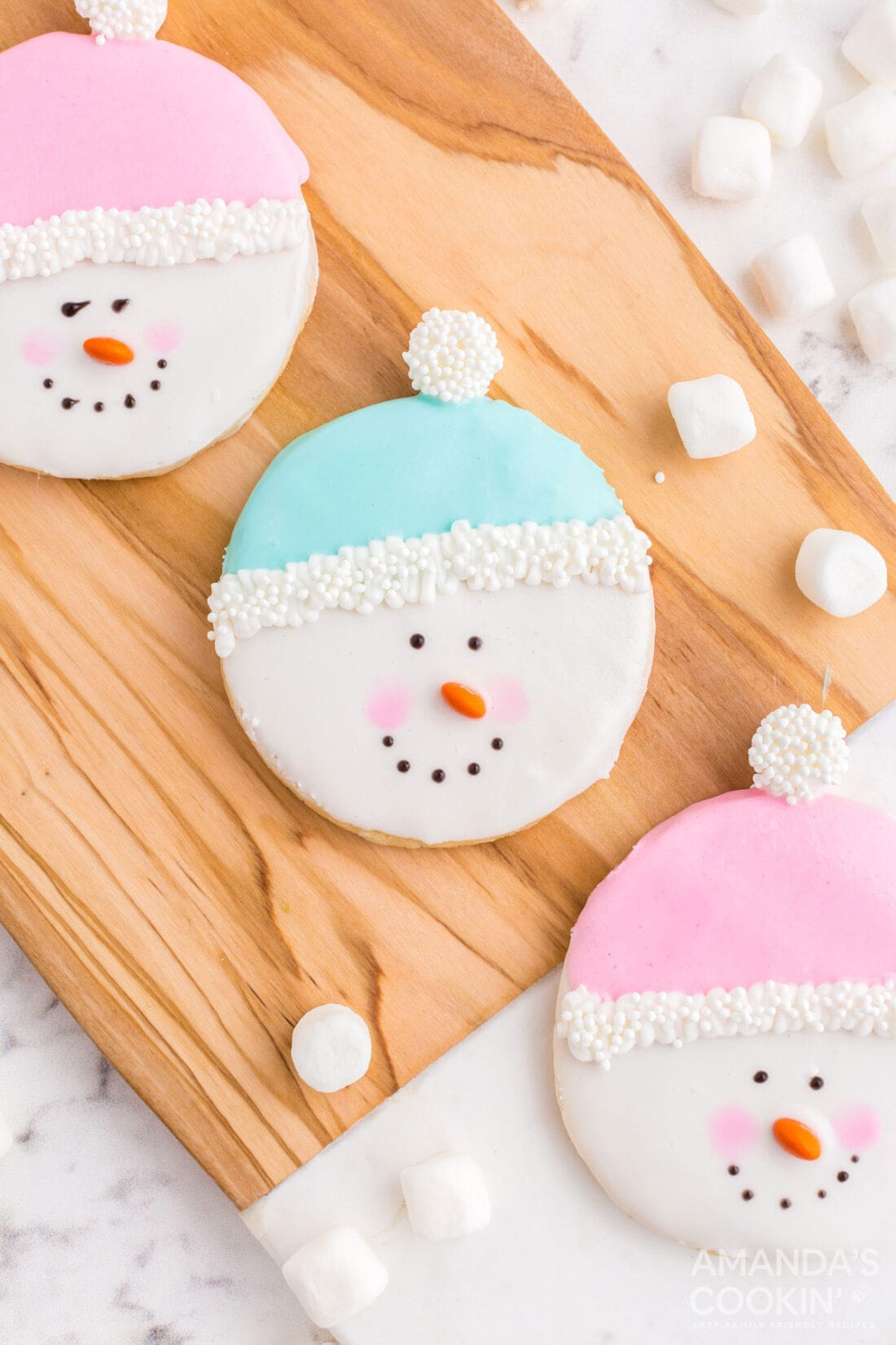 snowman cookies on cutting board