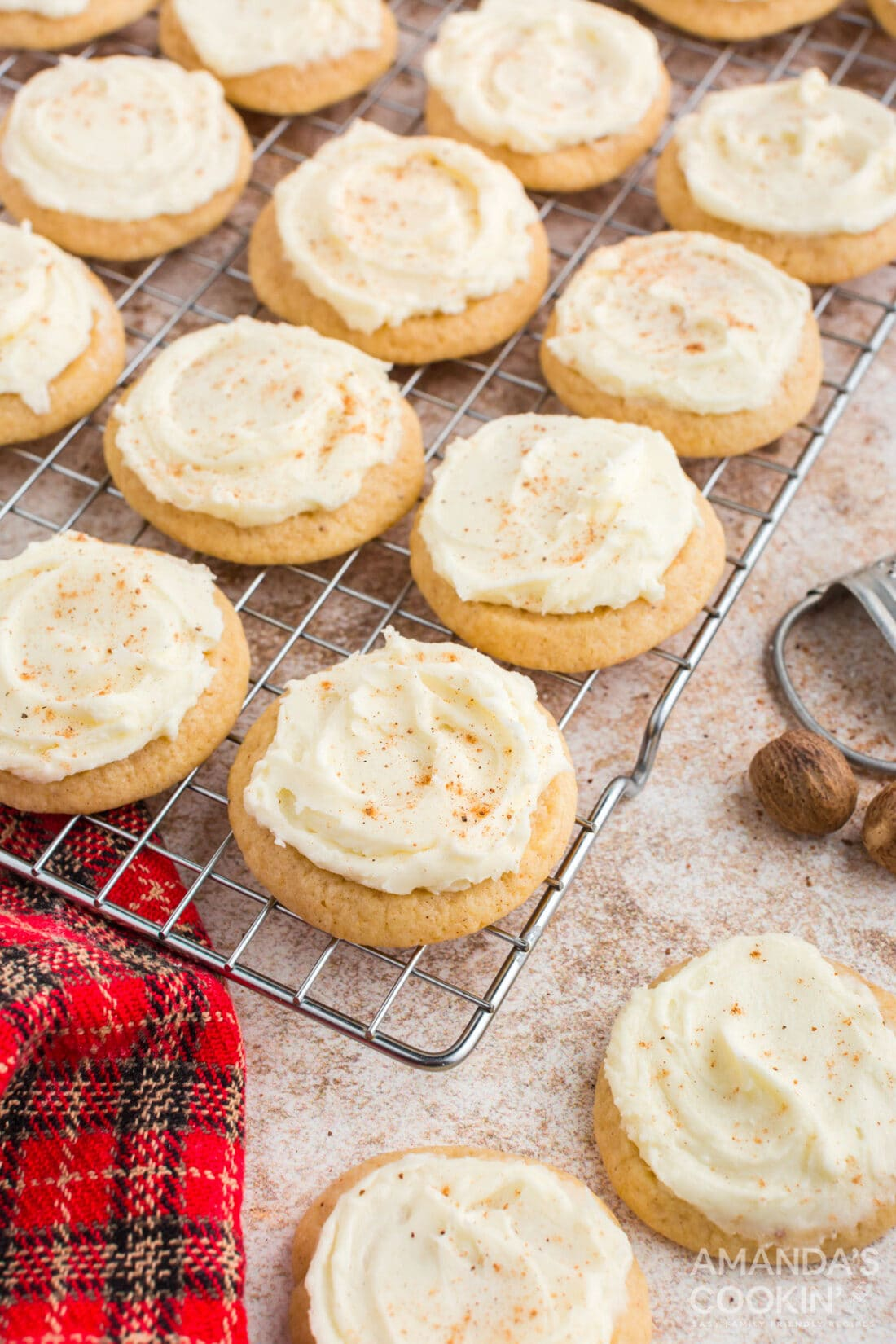 frosted eggnog cookies on a wire rack