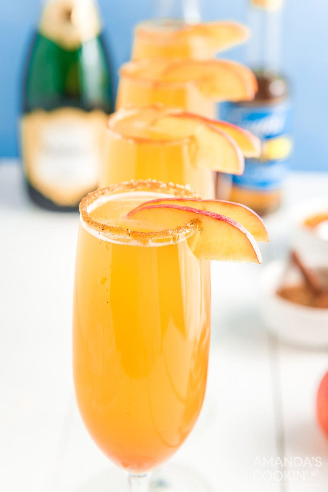 caramel mimosas garnished with apples