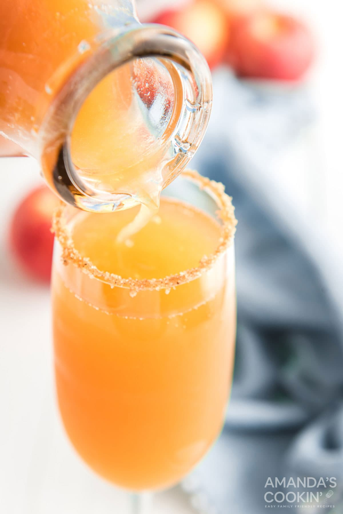 adding apple cider to glass