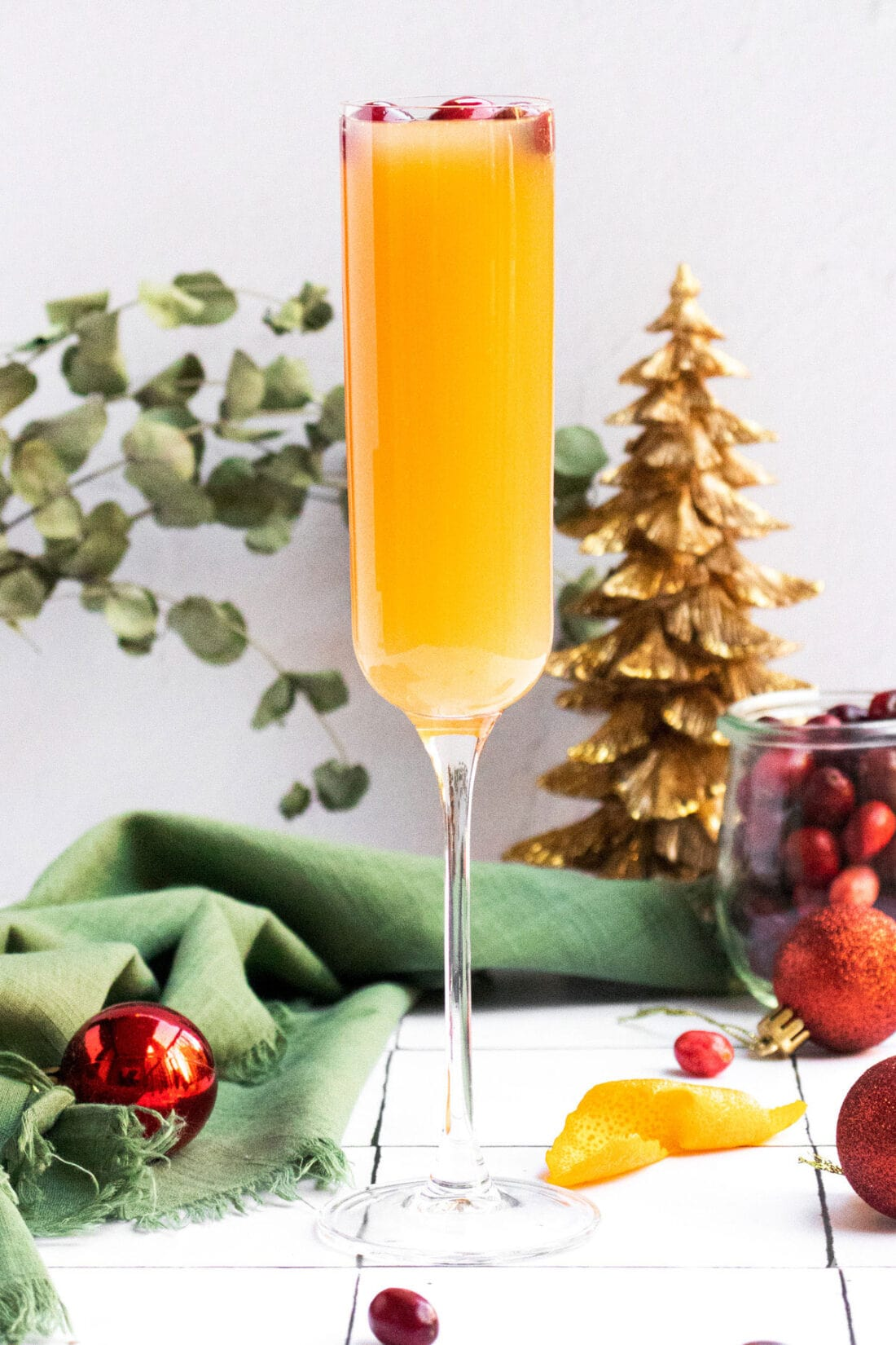 cranberry mimosa in a champagne flute