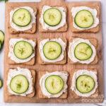 wood board of cucumber sandwiches