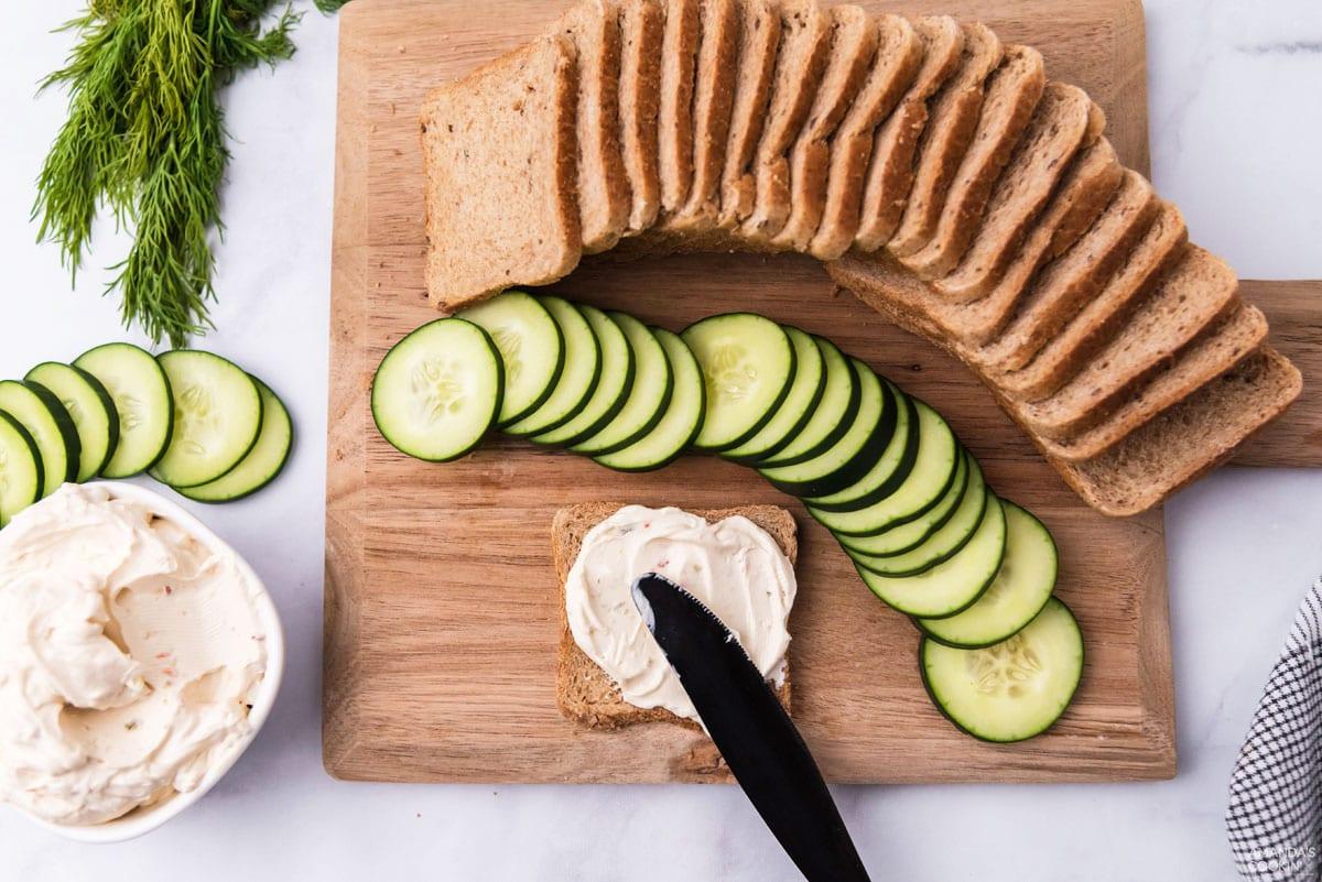 spreading cream cheese on bread