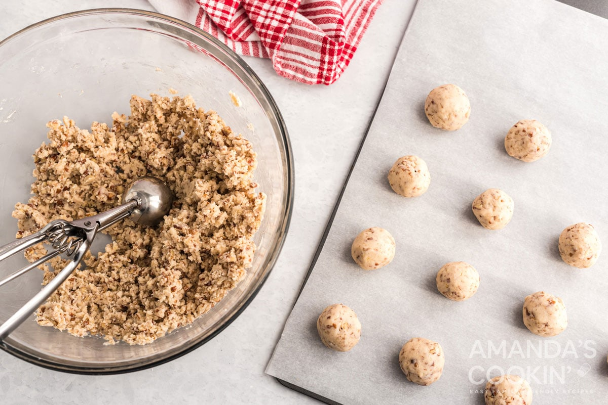 cookie balls on baking sheet