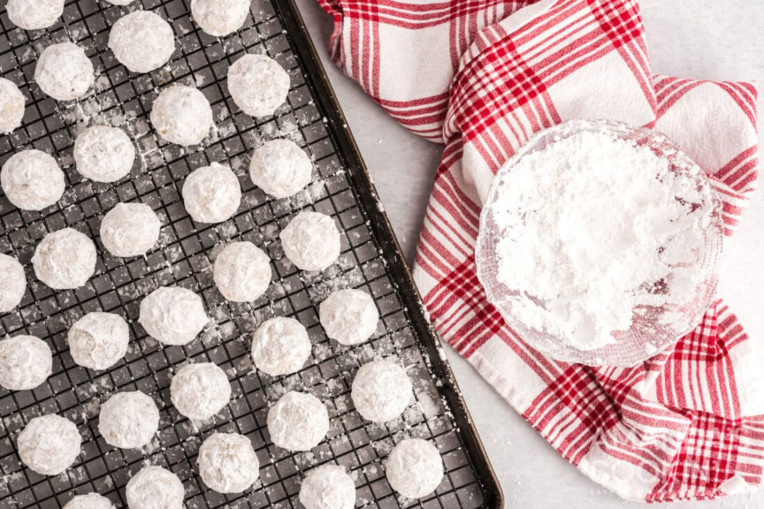 snowball cookies on wire rack