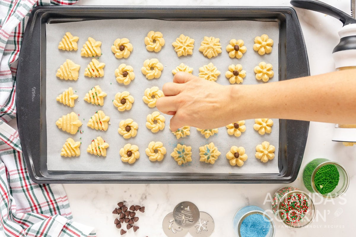 adding colored sugar to cookies
