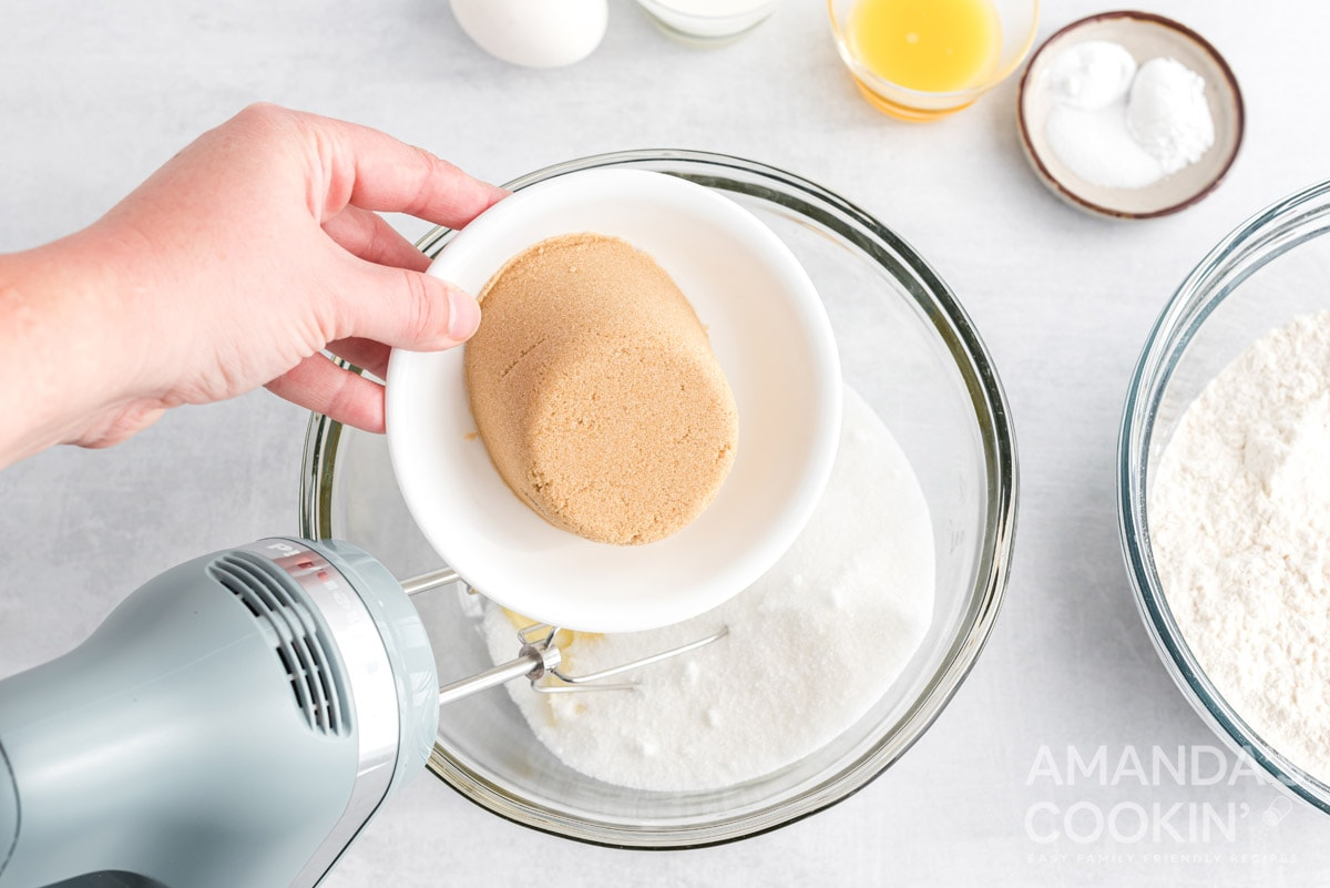 adding brown sugar to bowl