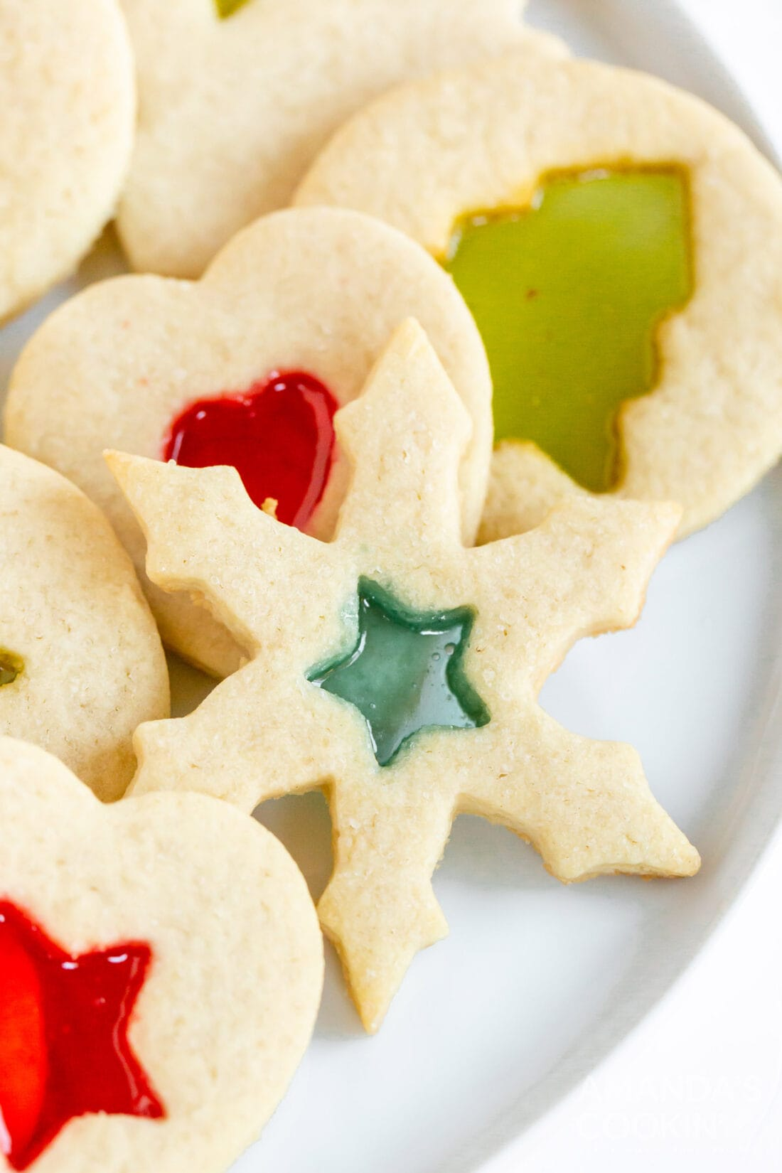snowflake shaped stained glass cookie