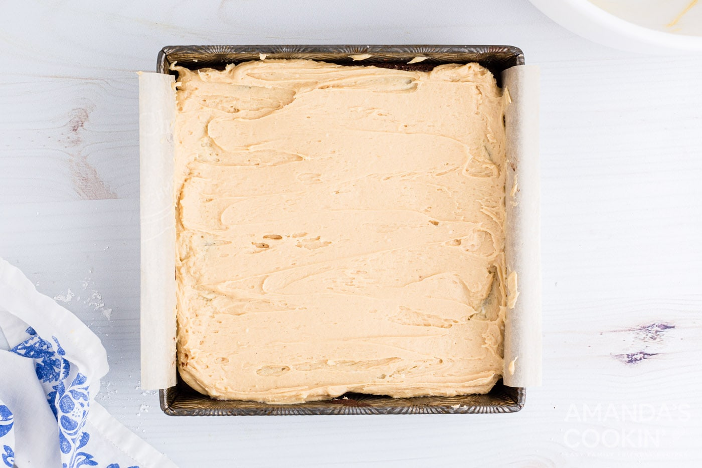 peanut butter frosting spread over brownies
