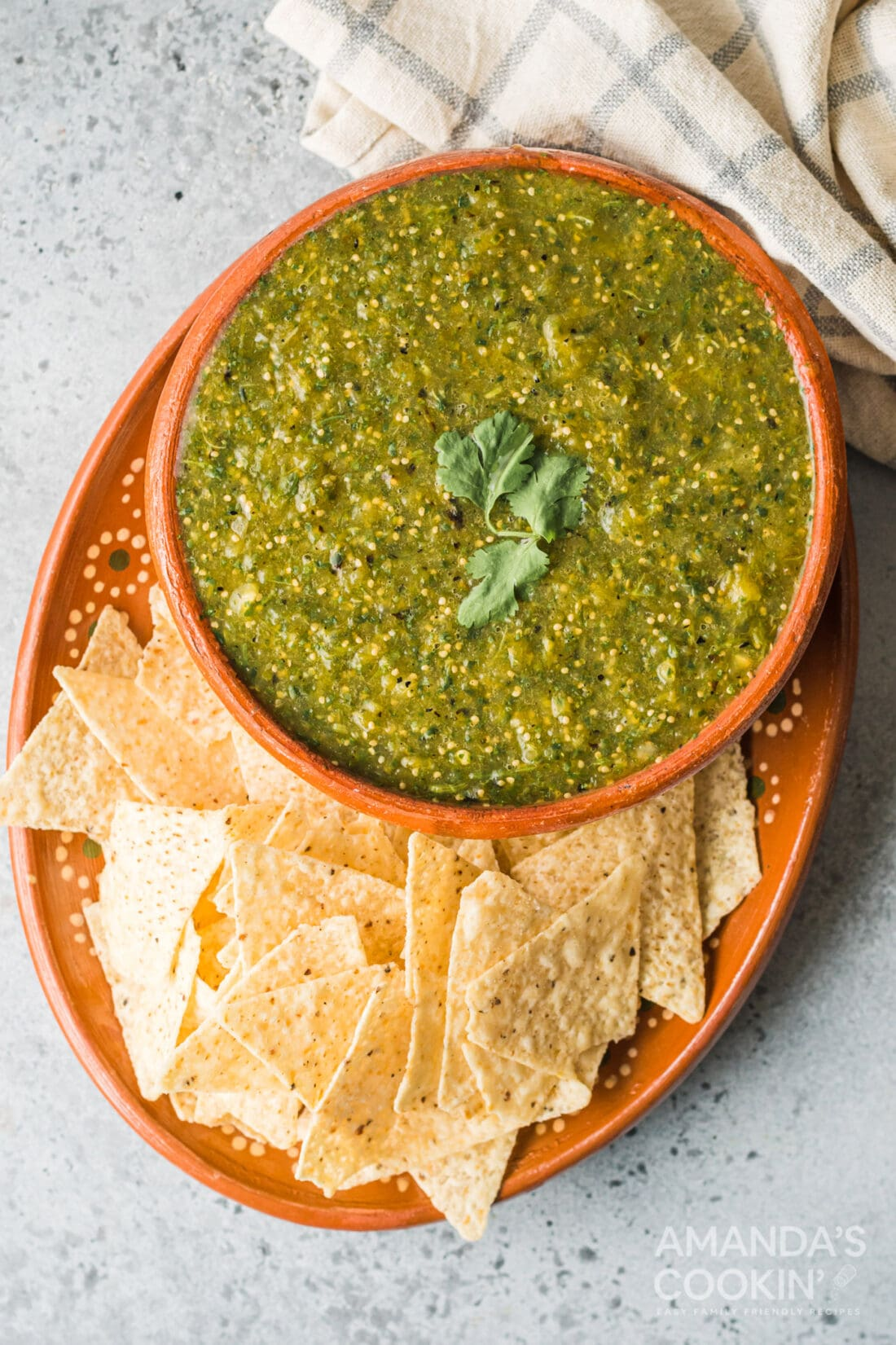 bowl of salsa verde with tortilla chips