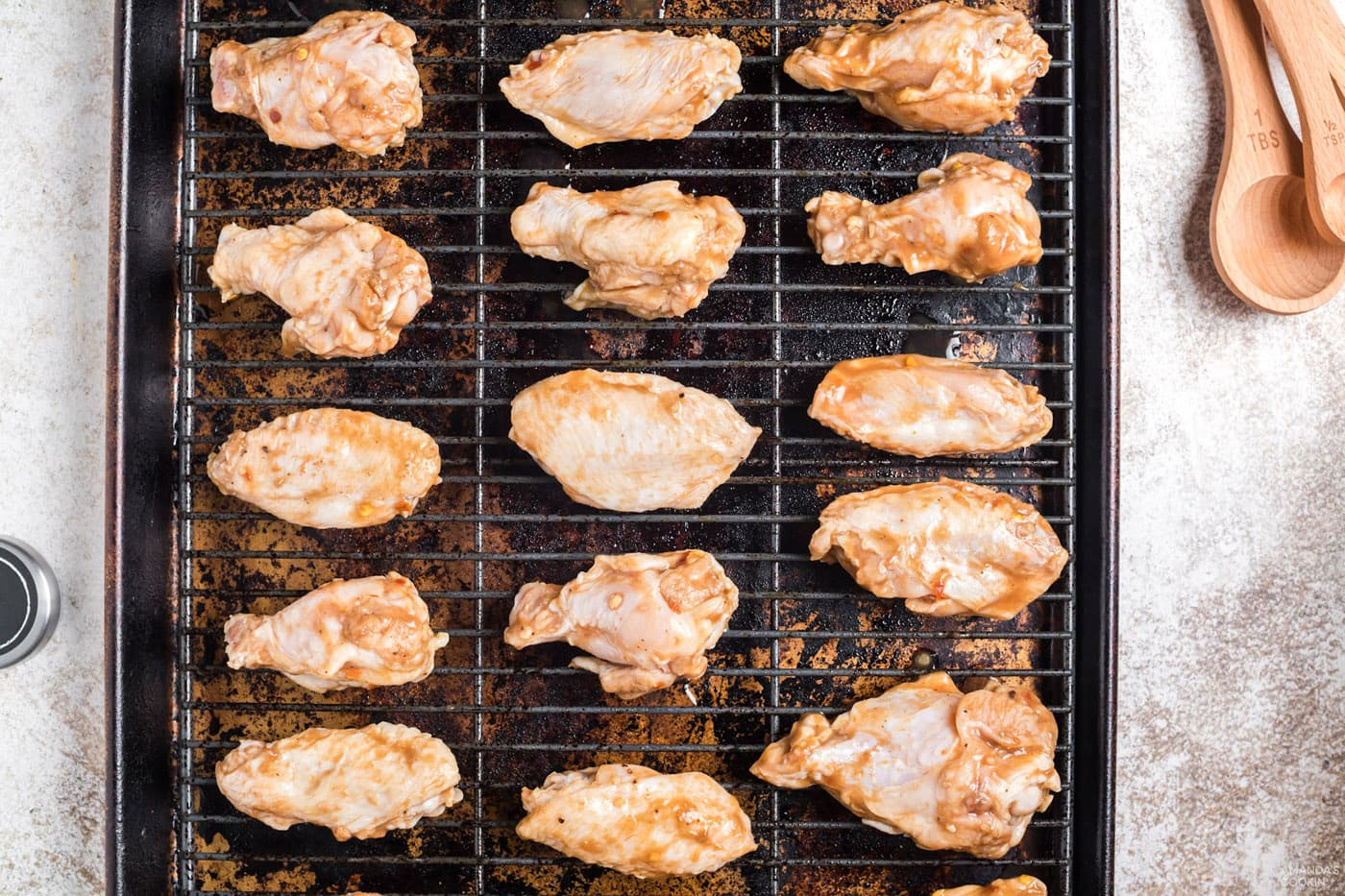 add chicken wings to a wire rack over a cookie sheet