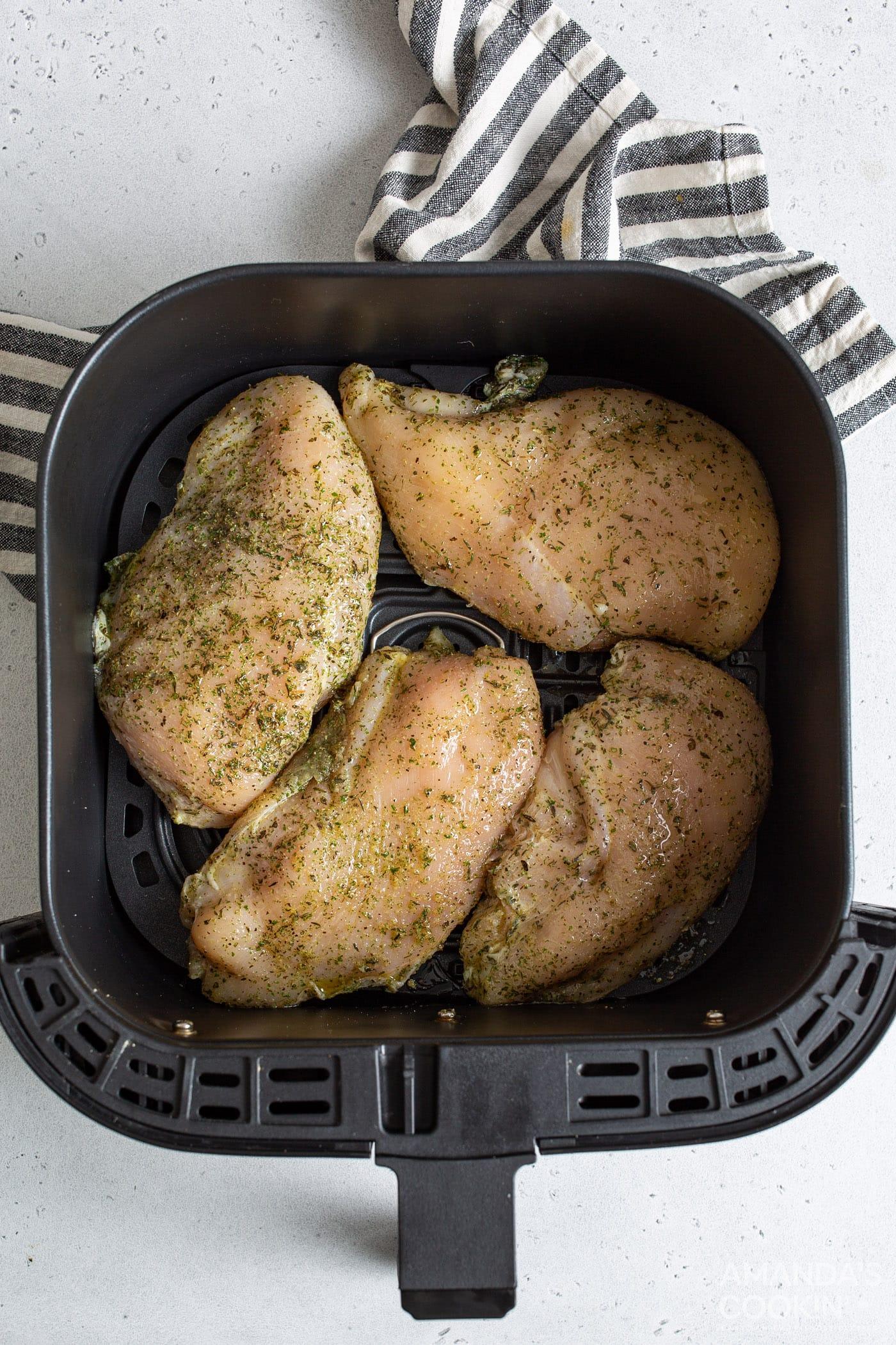 raw chicken in air fryer basket