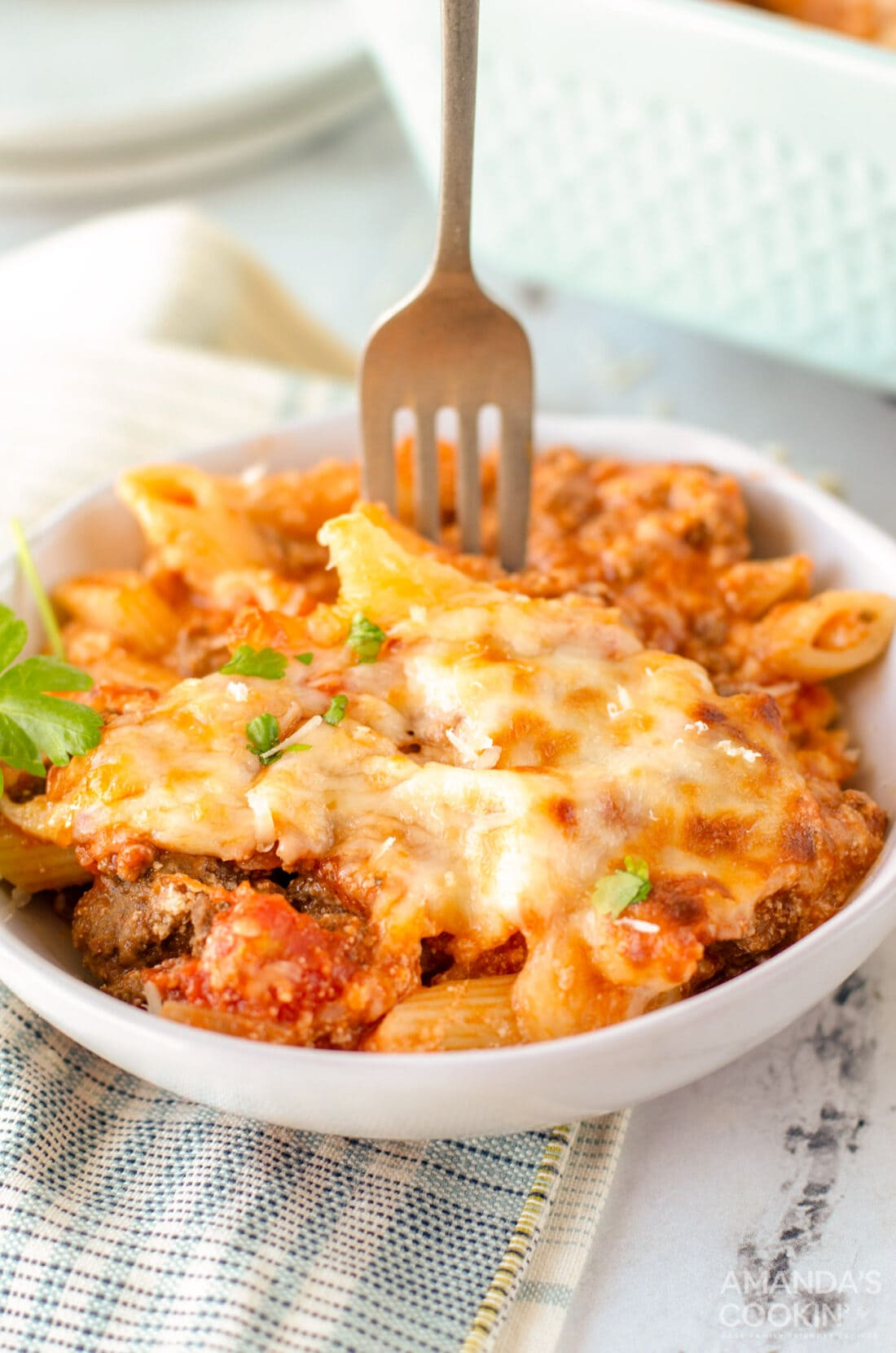 fork in a bowl of baked ziti